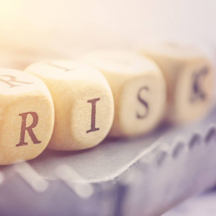 """Four dices are arranged in a word """"RISK"""""""