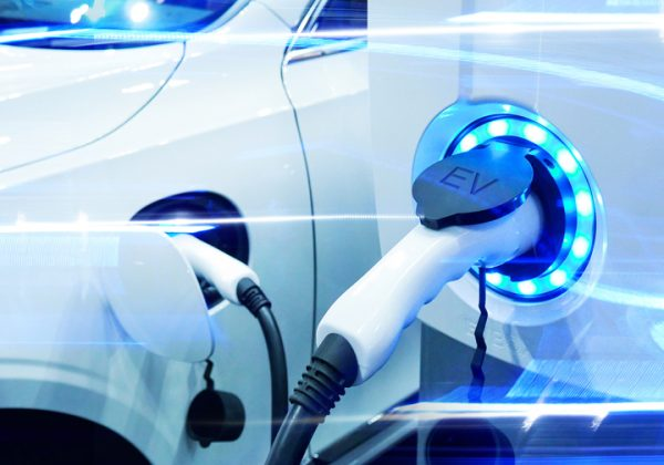 ower supply connect to electric vehicle for charge to the battery. Charging technology industry transport which are the futuristic of the Automobile. EV fuel Plug in hybrid car.