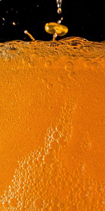 Fizzy orange drink in a glass