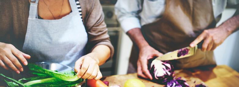 Man and woman preparing food