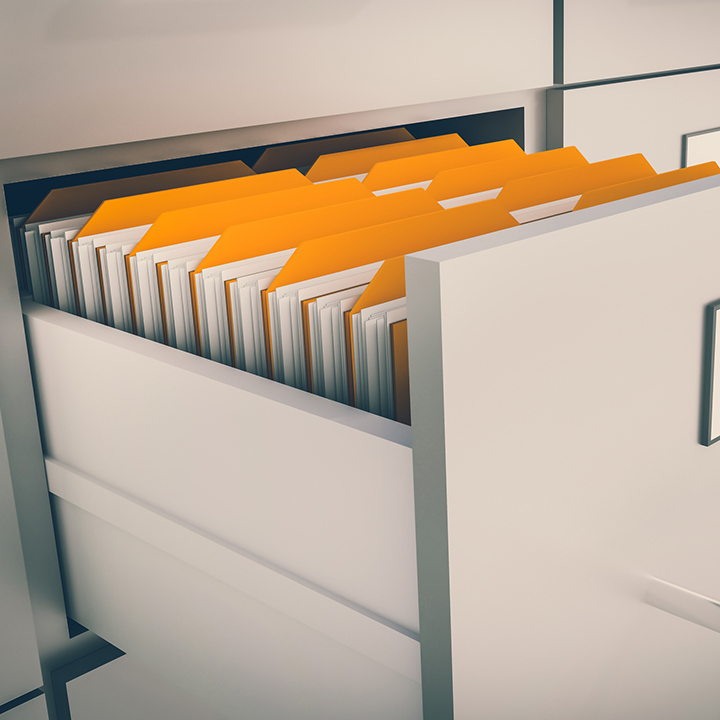 Open filing cabinet drawer with documents inside