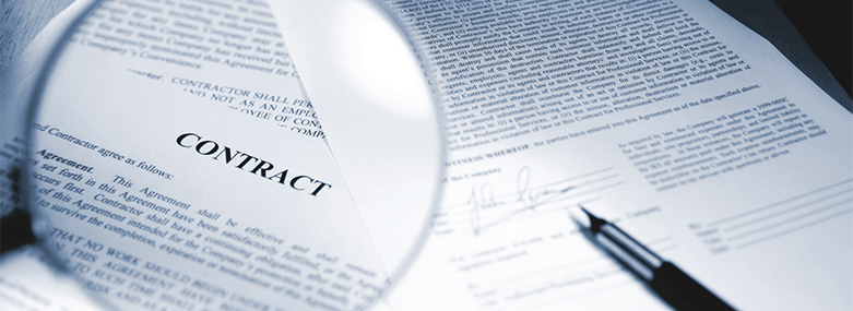 Contract_with_magnifying_glass_and_pen