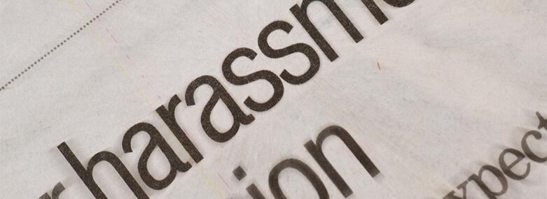 Harassment_headline_in_newspaper
