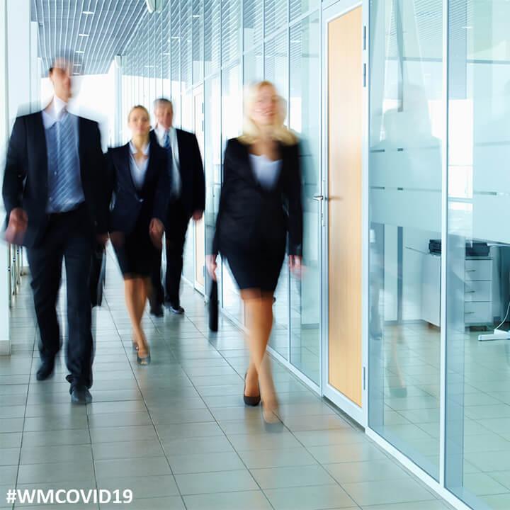 Business_people_in_corridor_WM#