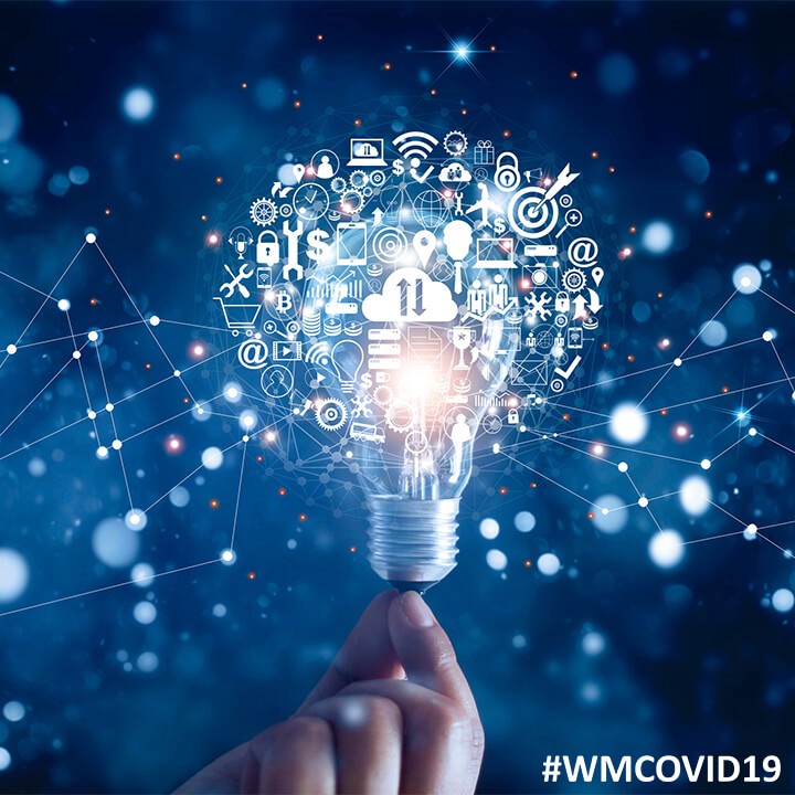 hand_holding_light_bulb_digital_technology_ideas