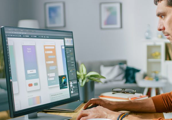 man homeworking at computer desk