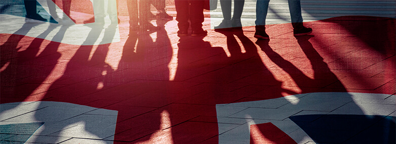 UK_flag_on_ground_and_Shadows_of_people
