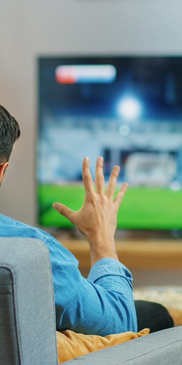 Football_fan_watching_on_TV