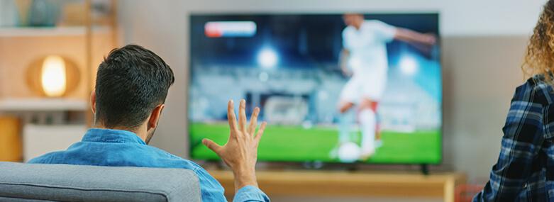 Football_fan_watching_on_TV