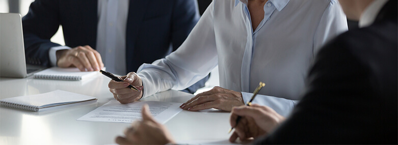 Business_woman_checking_agreement_before_signing