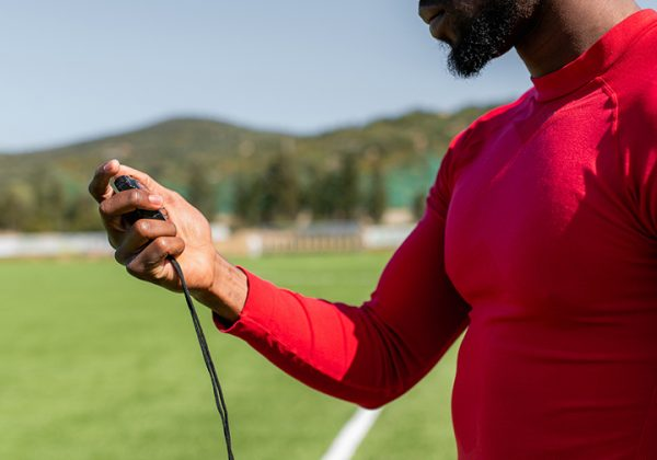sports_coach_checking_times_with_a_stopwatch