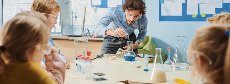 Teacher and Children in Science classroom