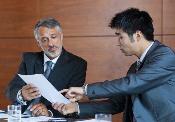 businessmen_working_on_paperwork