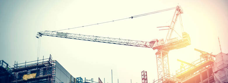 Unfinished office development with crane