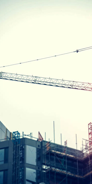 Unfinished office development with crane thumbnail