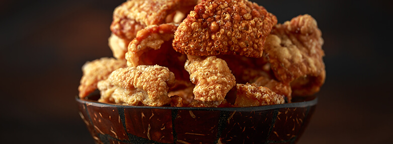 Crispy Pork scratchings. deep fries in bowl.